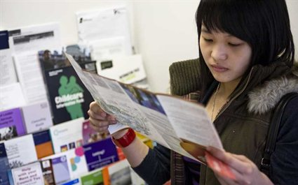 Student reading leaflet