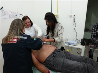 eHealth activities at Sao Jose Hospital in Palmares do Sul city: Photo-ECG (telecardiology) and teledermatology studies (Fizza is on the right)