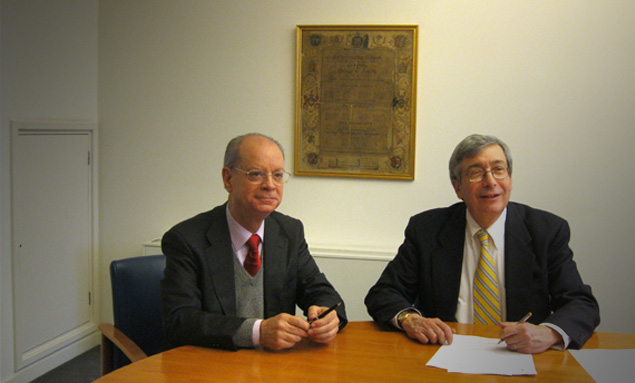 Professor Joaquim Clotet and Principal Rick Trainor sign the agreement
