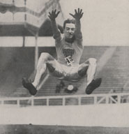 Photograph of RC Irons (USA) winning the running broad jump