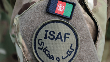 Close-up of Royal Marine's arm featuring ISAF badge
