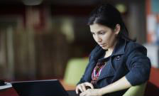 female-pg-student-with-laptop