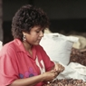 Woman sorting cocoa beans