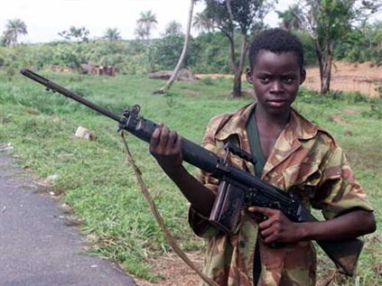 A young boy armed with a rifle in the 1991–2000 Sierra Leone conflict