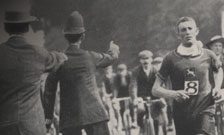 Photograph of London policemen cautioning cyclists during the marathon race at the 1908 Olympic Games