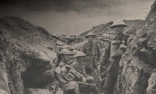 Reproduction of photograph depicting soldiers in a trench during First World War. From: George H Wilkins (ed.)  Australian war photographs (London: A.I.F. Publications Section, 1919)