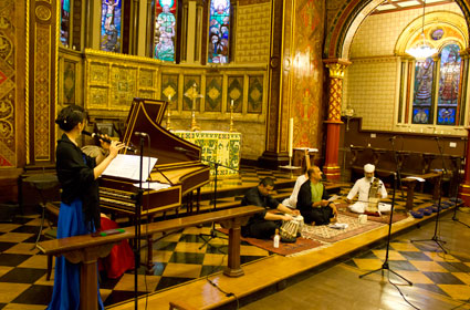 Photograph of musicians performing at the recital in the College Chapel