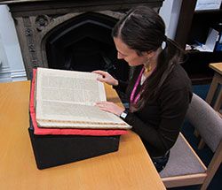 Sara Belingheri consulting a book in the Foyle Special Collections Reading Room