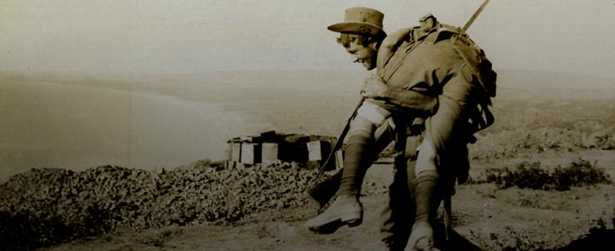 ANZAC soldier carrying wounded comrade on his shoulders ref: Hamilton 7_12_280