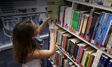 Student browsing books in Franklin-Wilkins Library