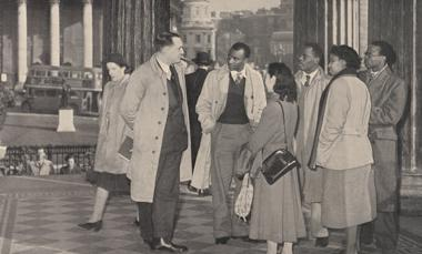 Group of students from the former British Empire, with the City of London in the background. From: Britain aids the colonies. Great Britain. Central Office of Information