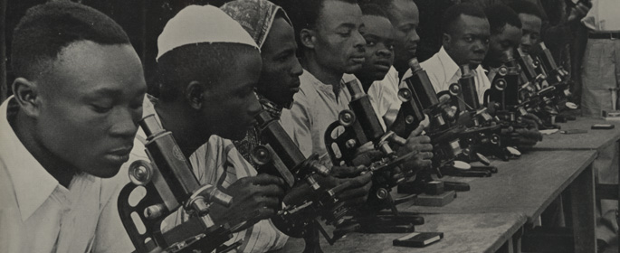 Photograph of a team of African microscopists at work. From: Great Britain. Central Office of Information. Battle against disease, 1949