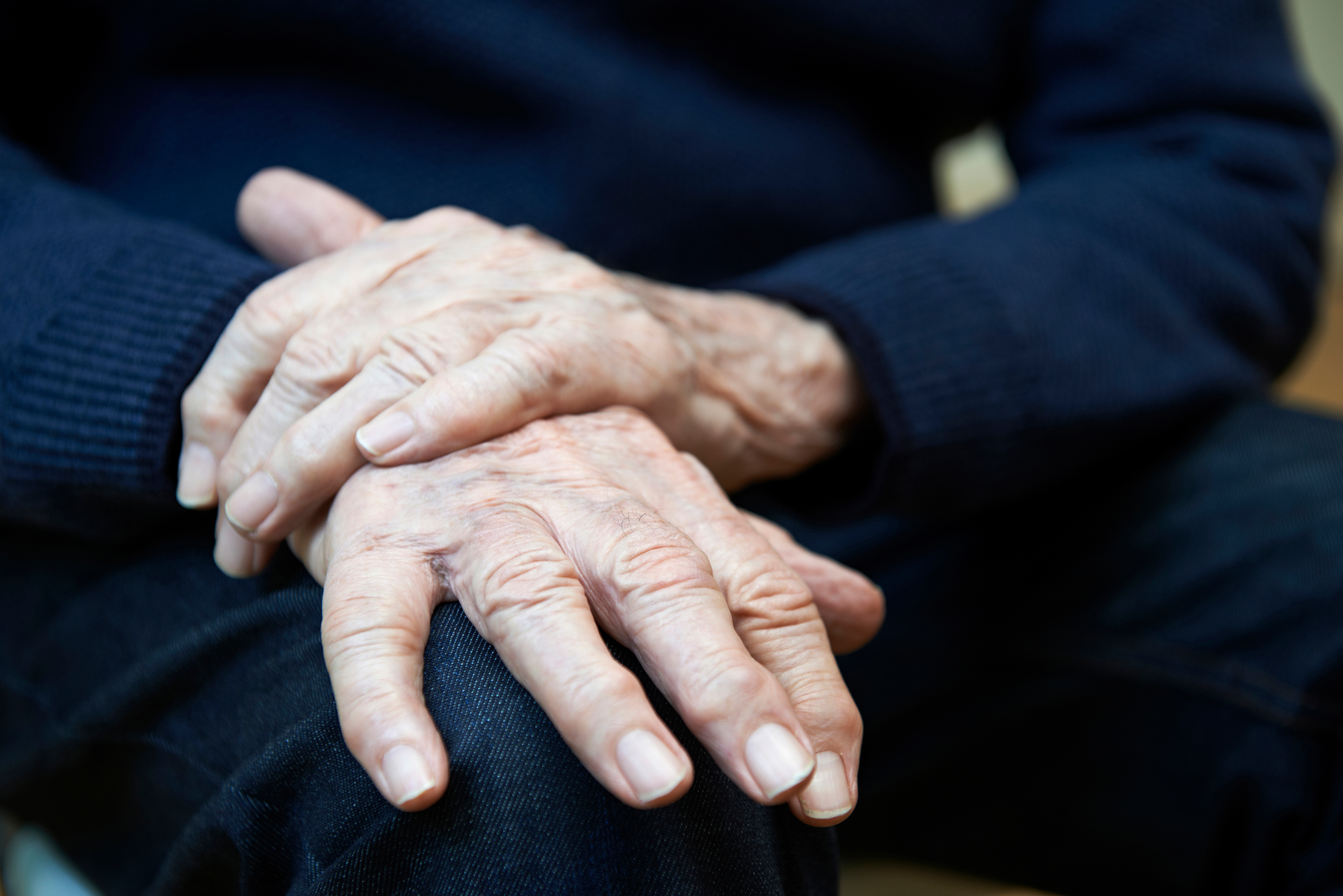 Old person hands Parkinsons