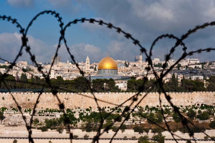 Jerusalem including Dome of the Rock in war through razor wire