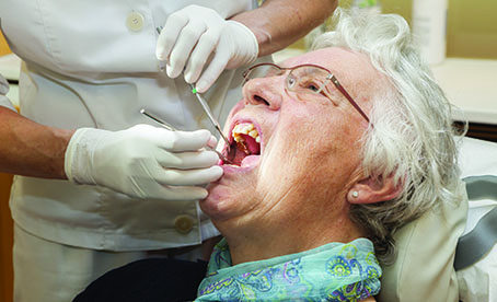 elderly patient dental front page puff