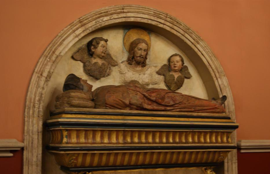 image of a statue of a tomb being overlooked by Jesus and two angels