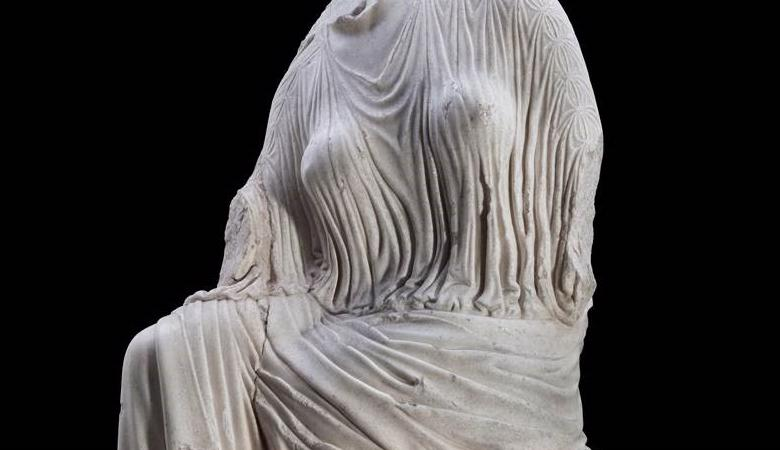 image of a marble statue depicting a woman's body