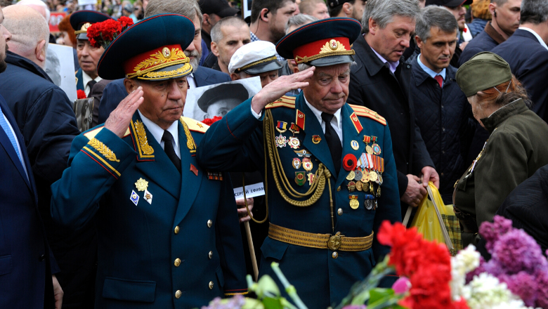 Veterans walking with flowers during the celebration of Victory Day in Ukraine