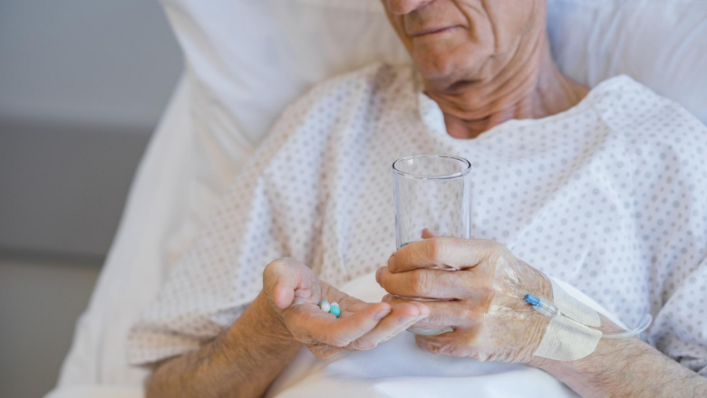 Elderly man taking medication in hospital