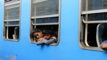 Children on a blue train, by Blanca Serrano