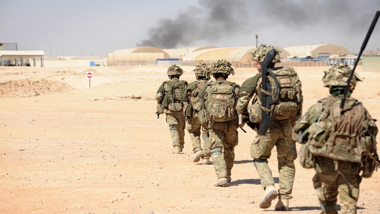 Soldiers walking through the desert