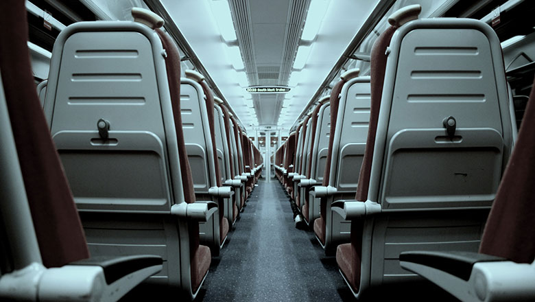 A view down the aisle of an empty train