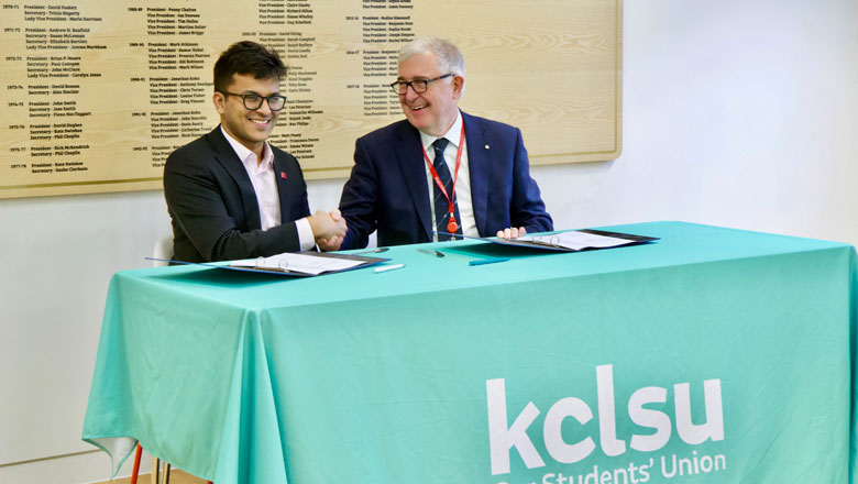 Principal Ed Byrne and KCLSU President shaking hands at agreement signing