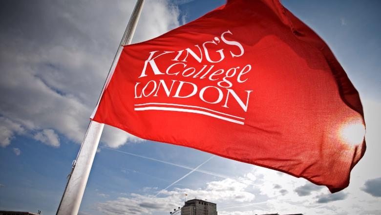 A red flag with the King's College London logo