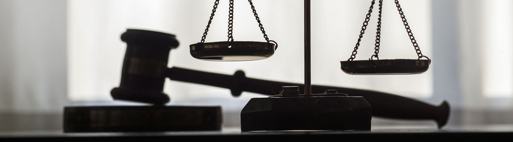 silhouette of gavel and scales