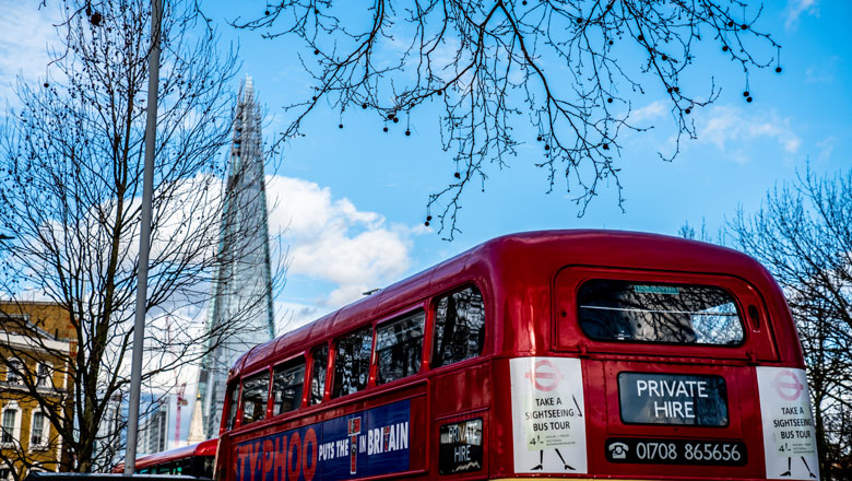 Classic red London bus in front of The Shard