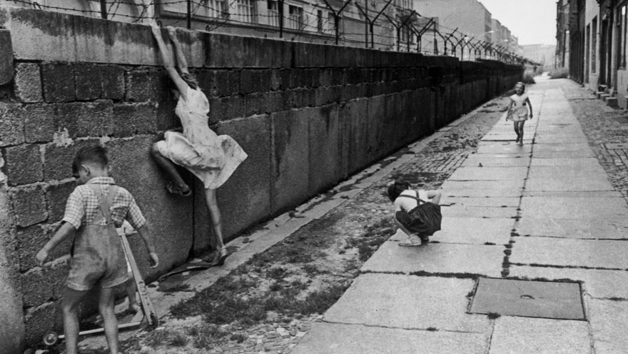 Children climbing the West Berlin Wall in 1962