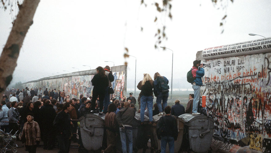 West German citizens gather at a newly created opening in the Berlin Wall at Potsdamer Platz in November 1989