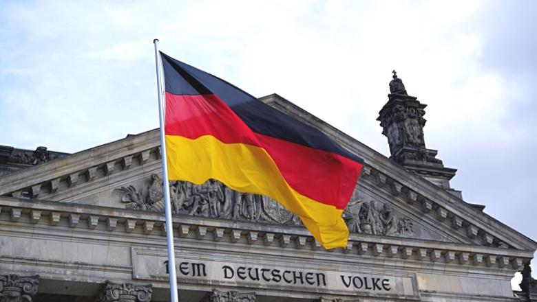 German flag flies in front of the Reichstag Building, Berlin
