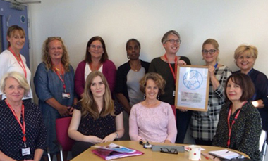 Staff with the accreditation certificate