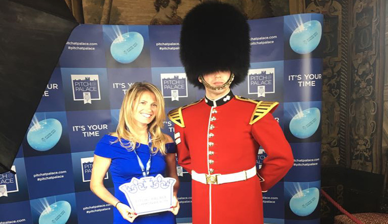 Robyn Klinger Vidra standing with a soldier at 'Pitch at the Palace'