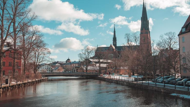 A river and church in Uppsala, Sweden
