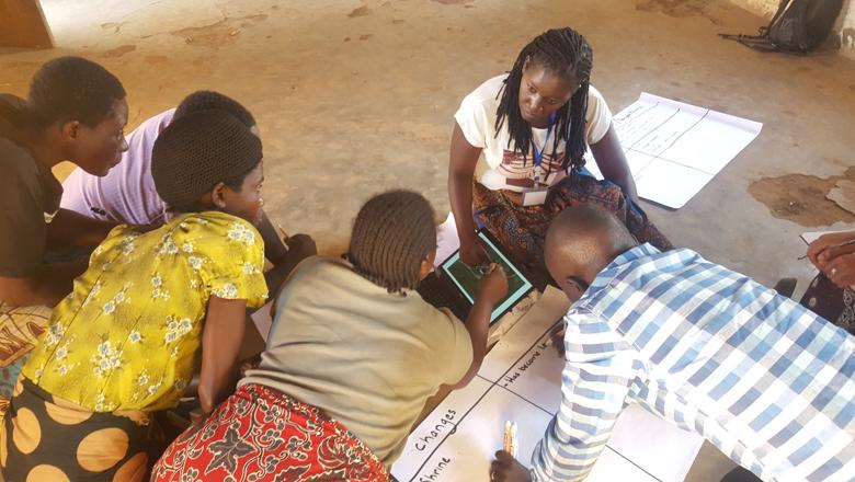 Discussing land use change with the help of remote-sensed images, Chinsamba Village, Malawi. Credit Genevieve Agaba, University of Southampton