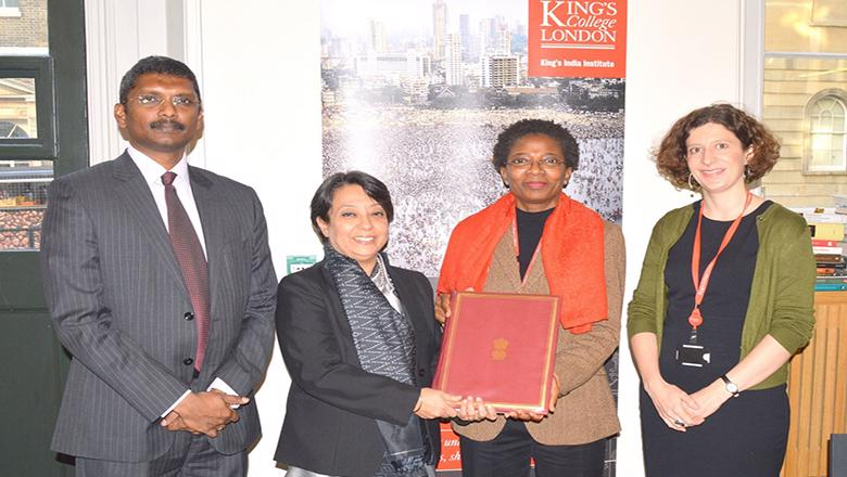 Louise Tillin and 'Funmi Olonisakin with colleagues for partnership signing