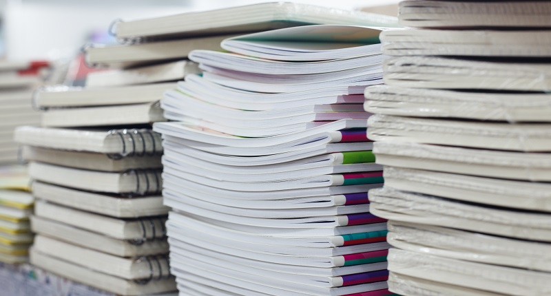 A stack of books and journals
