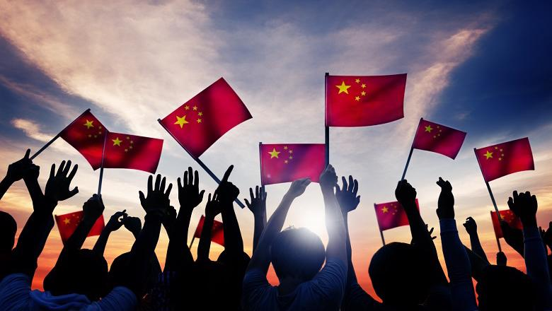 Chinese people waving the Chinese flag