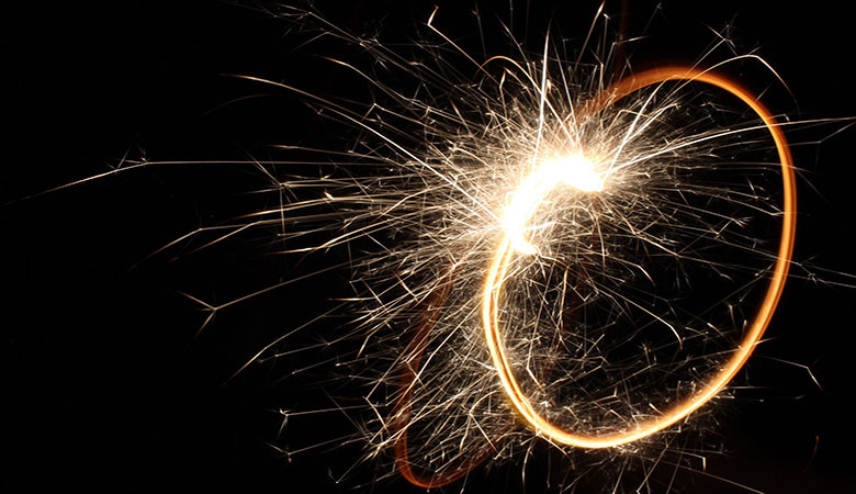 A sparkler against a dark background