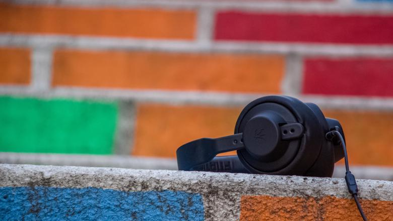 Music headphones in front of coloured bricks